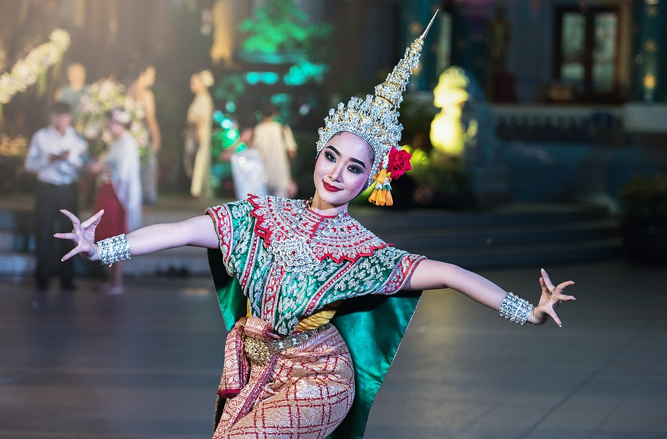 woman wearing a traditional asian costume while dancing