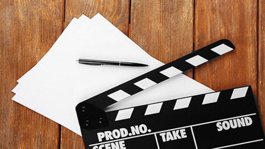 picture of movie necessities such as paper and pen and a cut strip