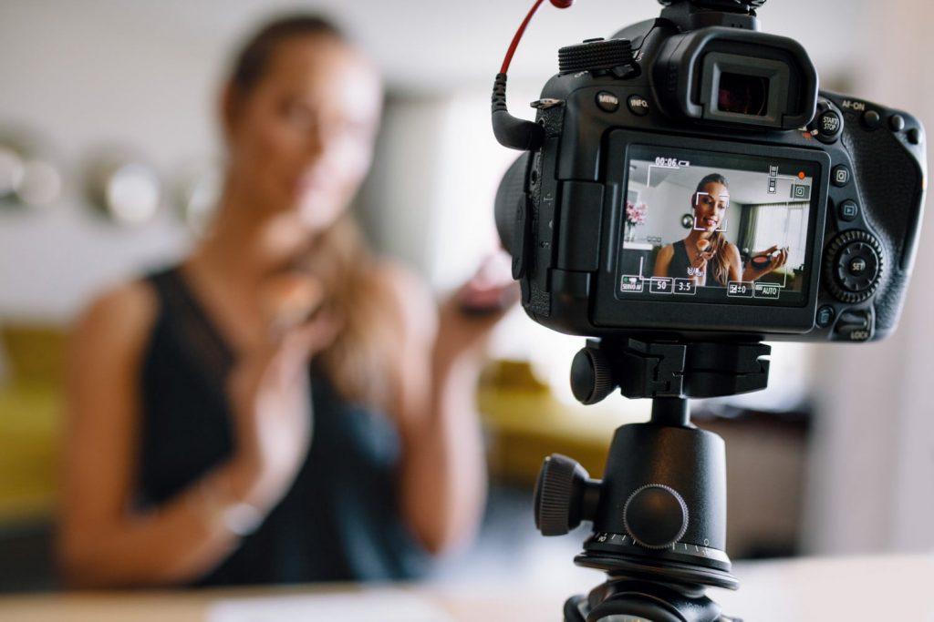 female vlogger recording on camera