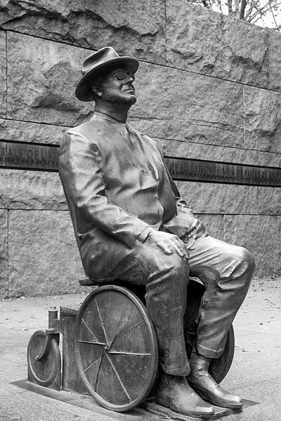A statue of Former President FDR in a wheelchair.
