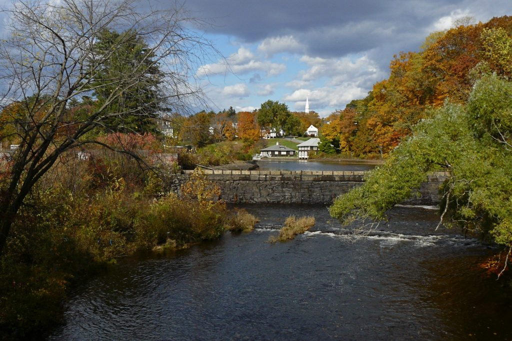 Mill River in the fall with colorful trees surrounding the river.