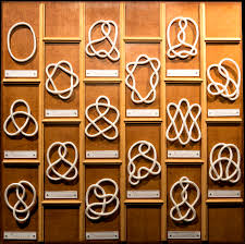 an array of different knots on a wall