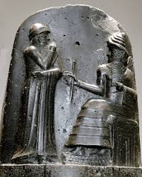 figures atop of the stele of the Code of Hammurabi