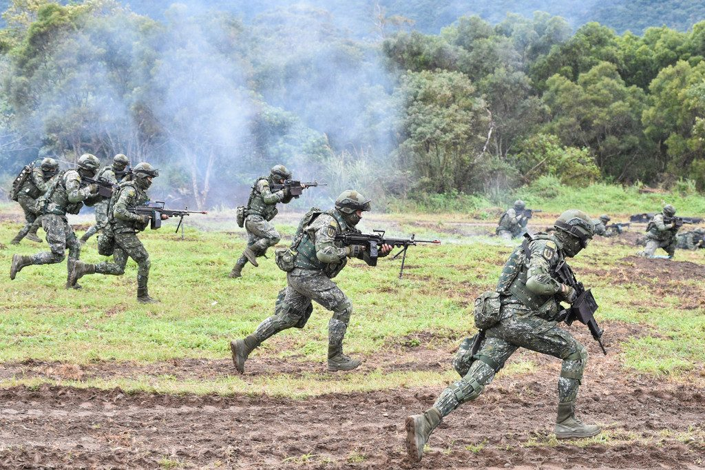 Taiwanese soldiers simulate fending off an attempted invasion during an annual drill at the military base in Hualien on Jan. 30.