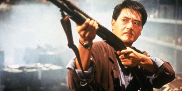 a scene from a foreign movie man holding gun