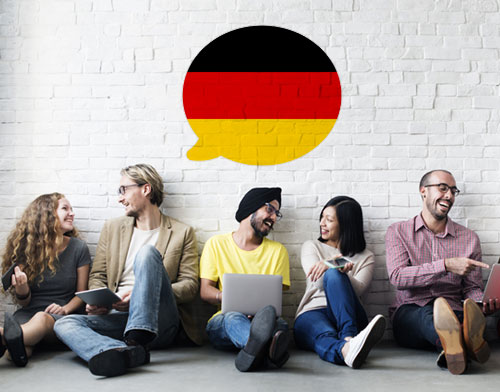 people having conversation in German, speech bubble with German flag on way (black, red, yellow stripes top to bottom)