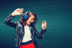 A girl listening to music and dancing