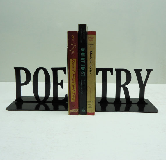 "A sign that says ""poetry"" with three poetry books in the middle of the word."