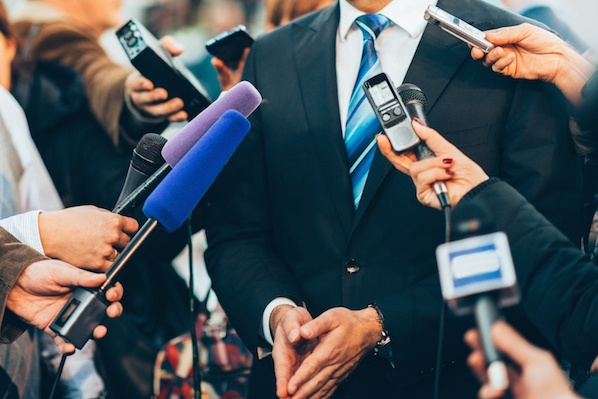 a person being interviewed with mics near him
