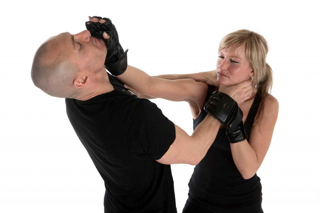 two people engaging in self defense moves