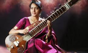 woman playing Indian instrument, the sitar