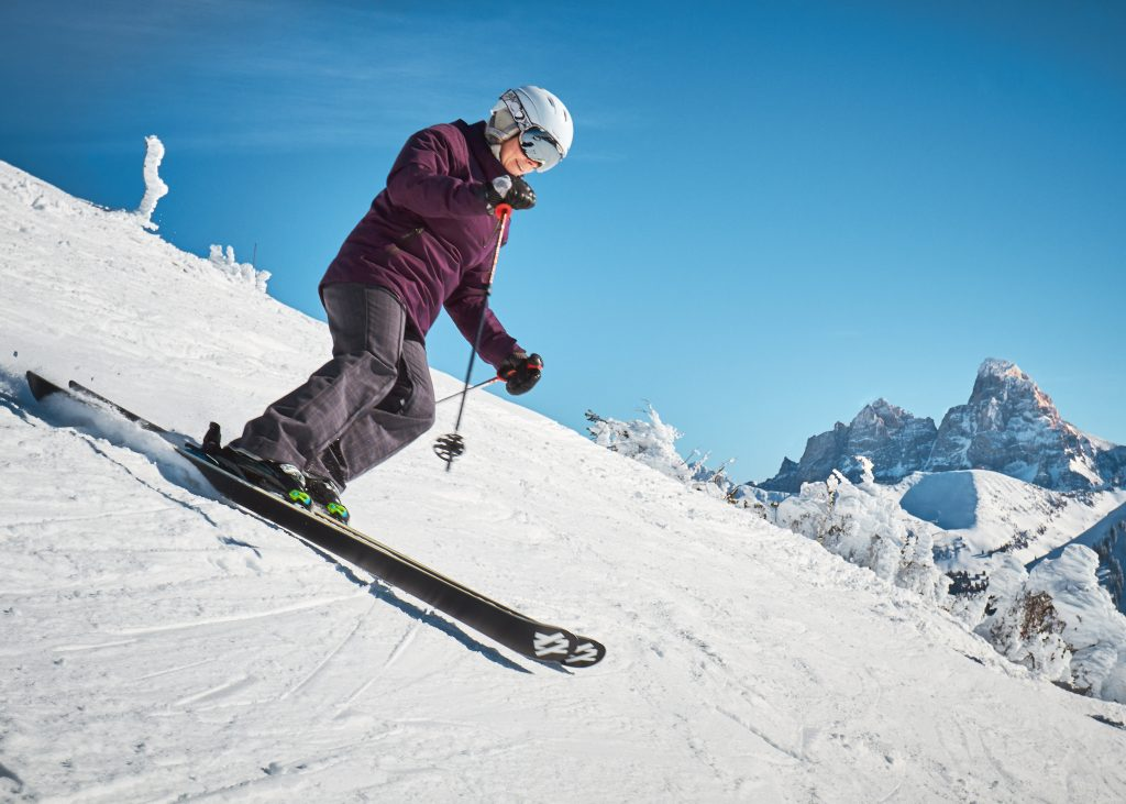 An image of a person skiing down a snowy slope