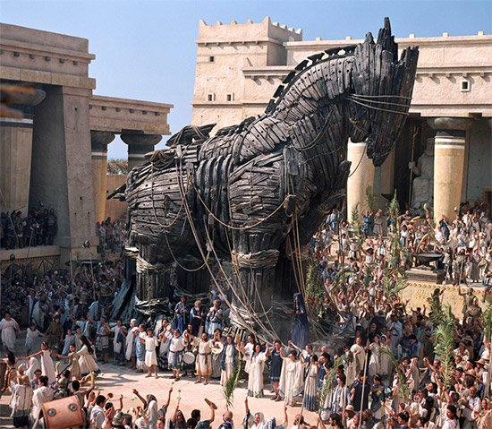 The Trojan War with a big wooden horse in the middle of the city.