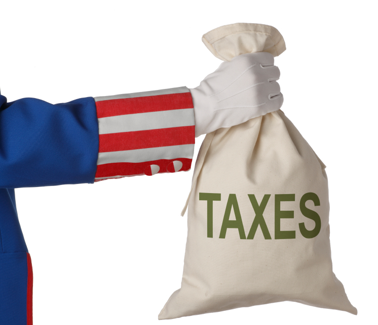 uncle sam hand holding a bag with the word taxes on it