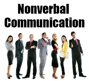 People in office wear with the words nonverbal communication written above them