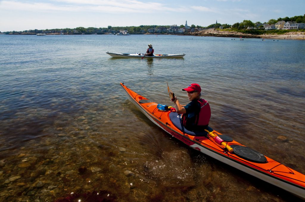 two people on the water on kayaks