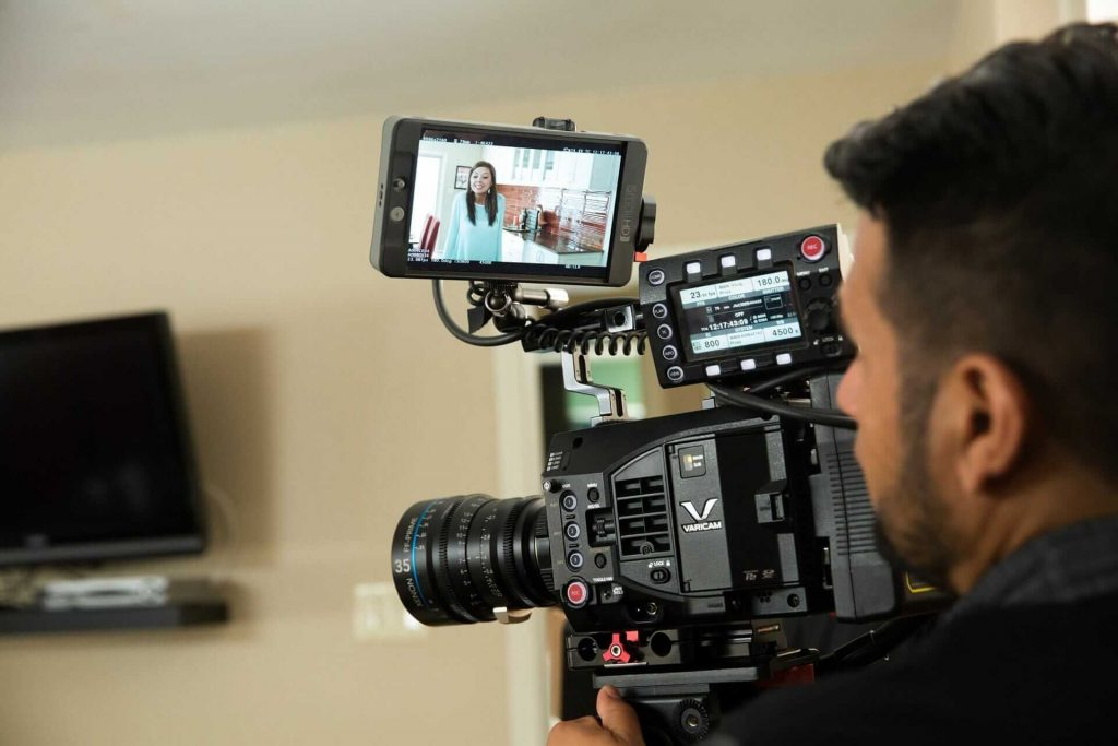 A person shooting a video using a digital camera