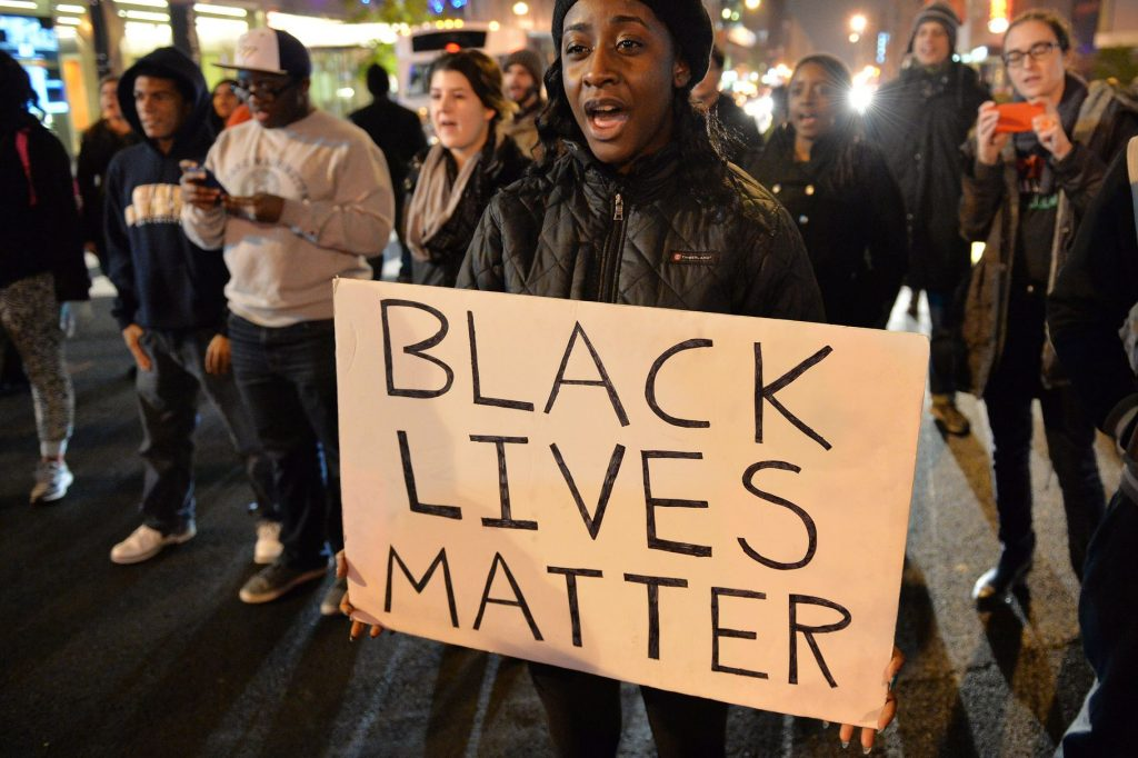 image of activist holding up black lives matter sign