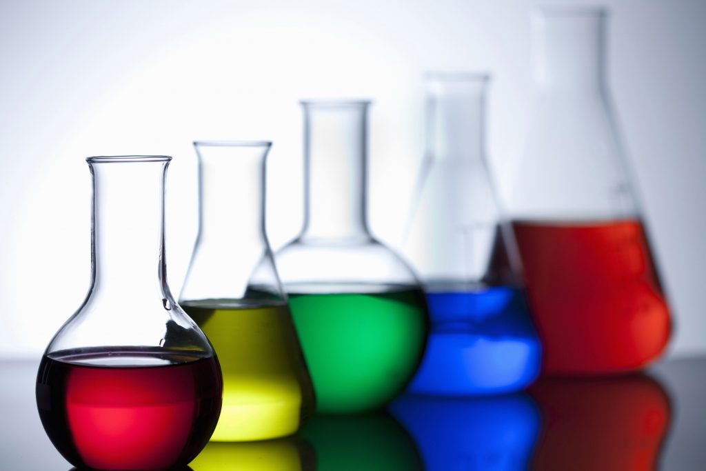 Chemistry beakers filled with different colored liquid.