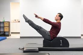 a man in a stretch position at the gym