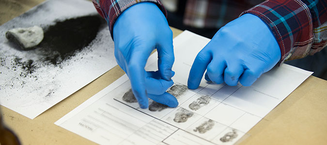forensic scientist matching fingerprints