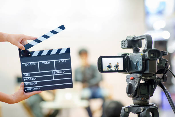A digital camera filming in a film set