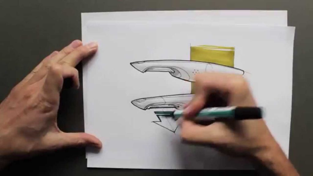 A person drawing a sketch on a piece of paper