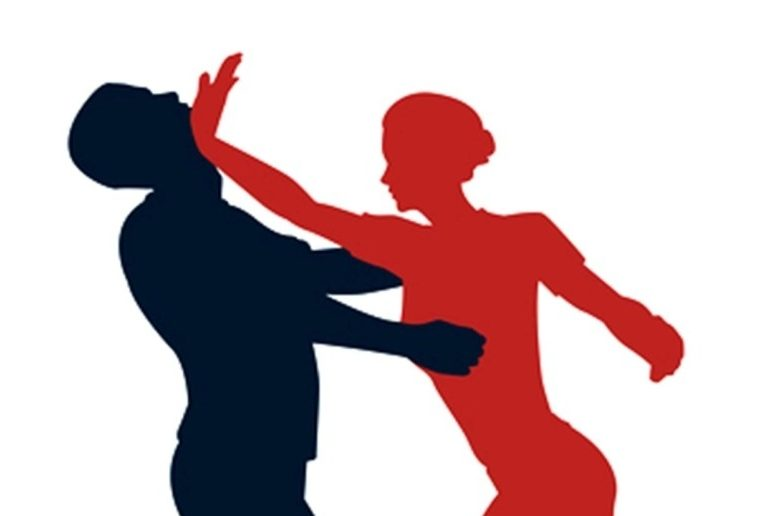 silhouette of two people engaging in self defense
