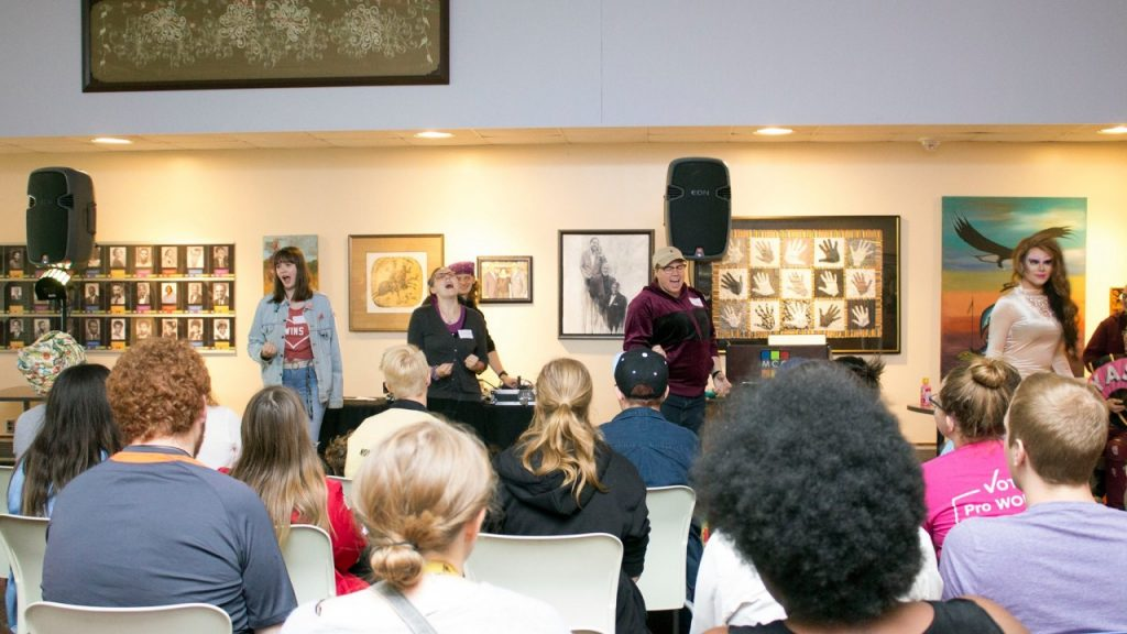picture of people speaking in front of a crowd of people at an event