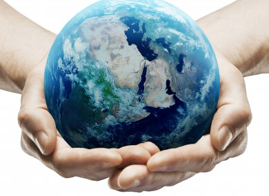 A person holding the world in their hands