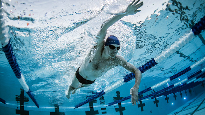 A male swimmer inside a pool