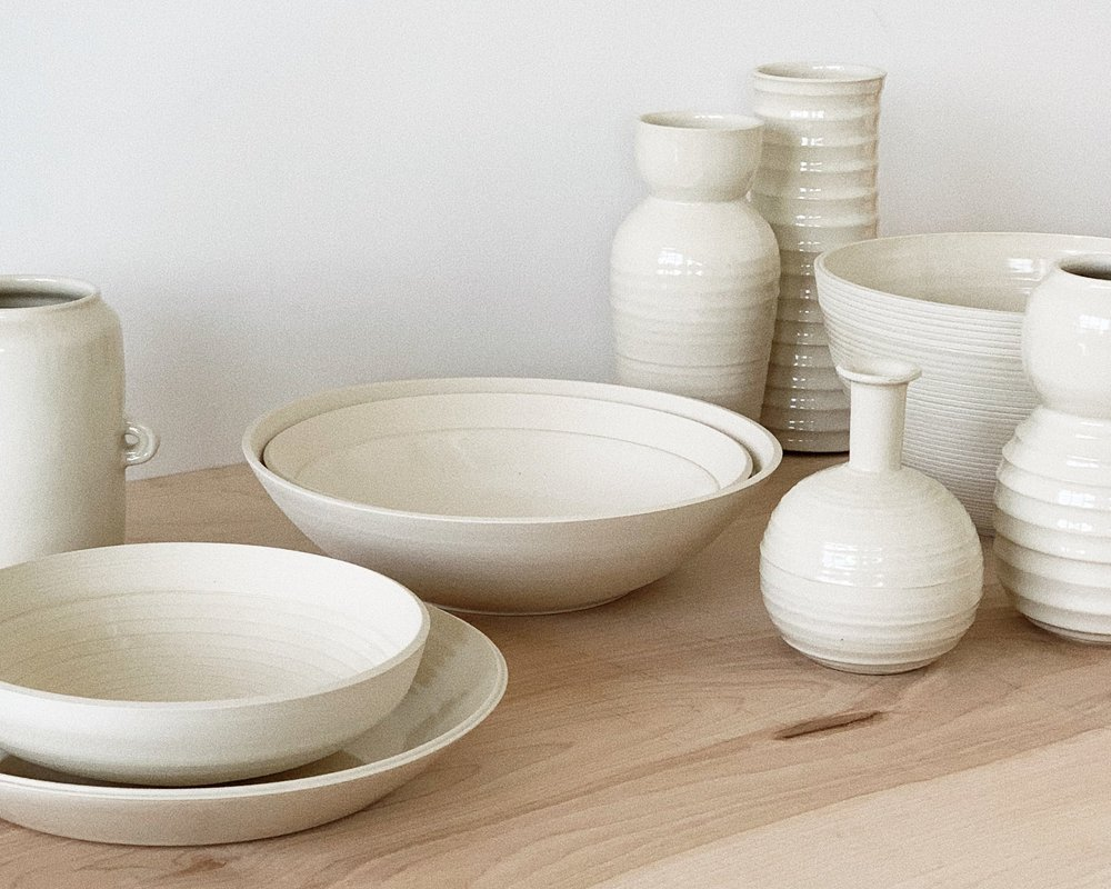 Ceramic bowls and bottles placed on a table