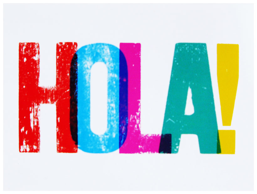 A word HOLA written in colorful letters