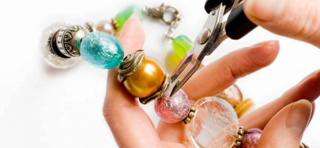picture of hands using tools to make jewellry
