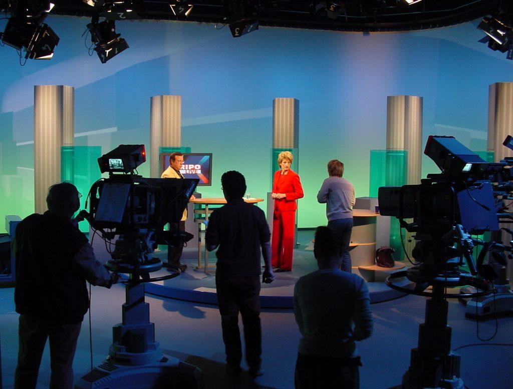 A broadcasting team inside a studio