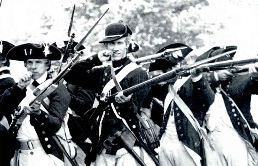 Ancient soldiers wielding riffles in a black and white picture
