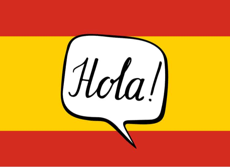 """The Spanish flag with a word bubble written """"Hola!"""""""