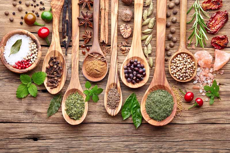 wooden spoons with herbs and spices