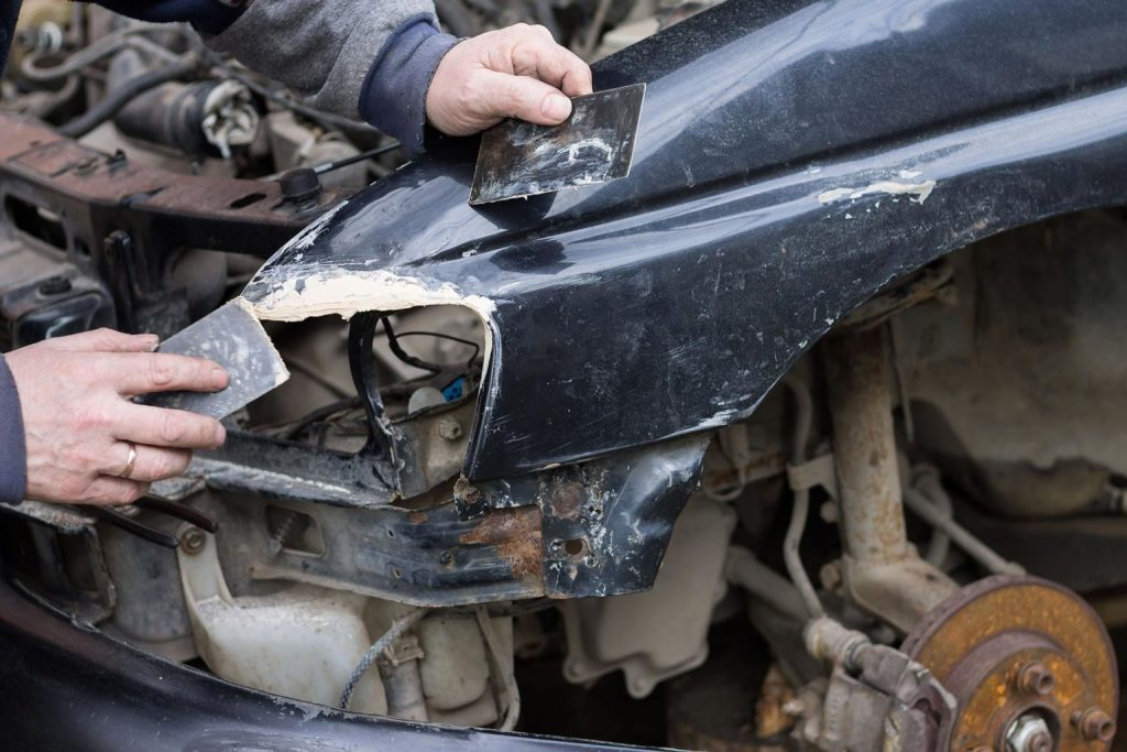 A damaged car being reparied
