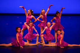 Female dancers performing a jazz dance on stage