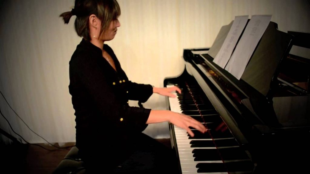 A female playing a piano