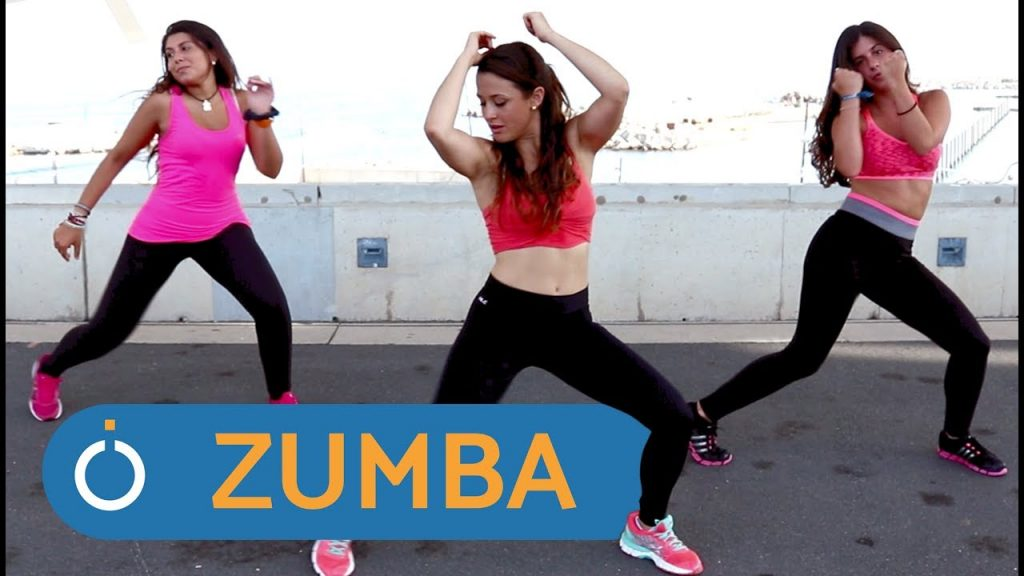 Three zumba dancers performing a routine