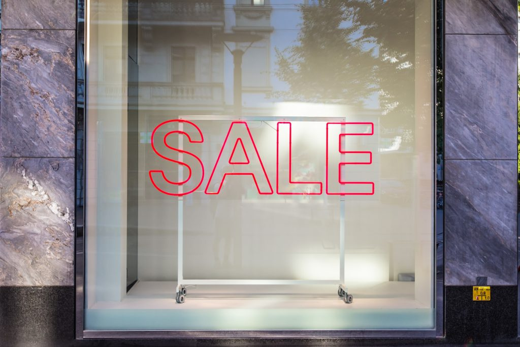 sale sign in a clear glass window