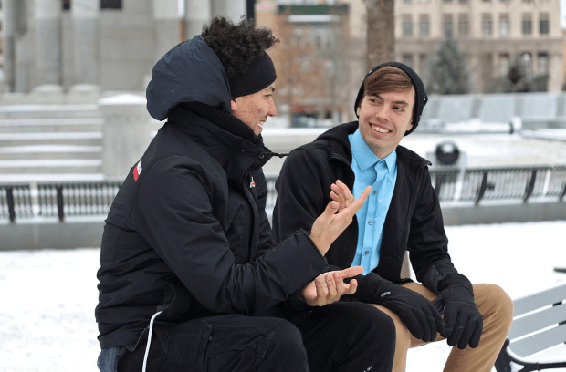 two guys having a conversation outdoor during winter