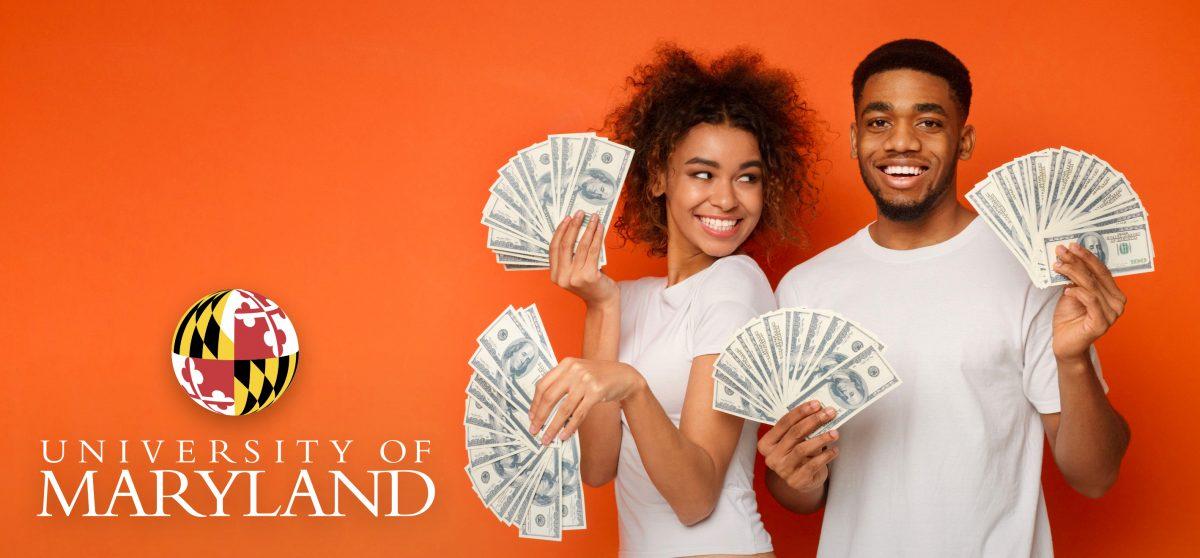 two university of maryland students holding money