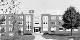Clement Hall building with trees in black and white.