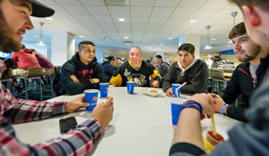 Students gathered around a table at the Gemmell Food Court.