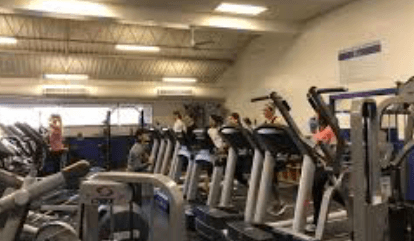 Students working out in one of the many fitness rooms located in Bell Center.