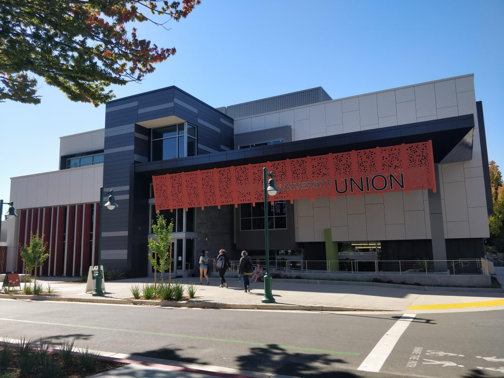 "The union during the day with a red ""union"" banner hanging in the front."