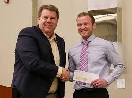 student receiving sugar beat award